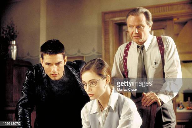 Actors Tom Cruise as Ethan Hunt Emmanuelle Beart as Claire Phelps and Jon Voight as Jim Phelps in a scene from the film 'Mission Impossible' 1996