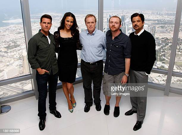 Actors Tom Cruise Paula Patton director Brad Bird and actors Simon Pegg and Anil Kapoor attend a photocall ahead of the 'Mission Impossible Ghost...