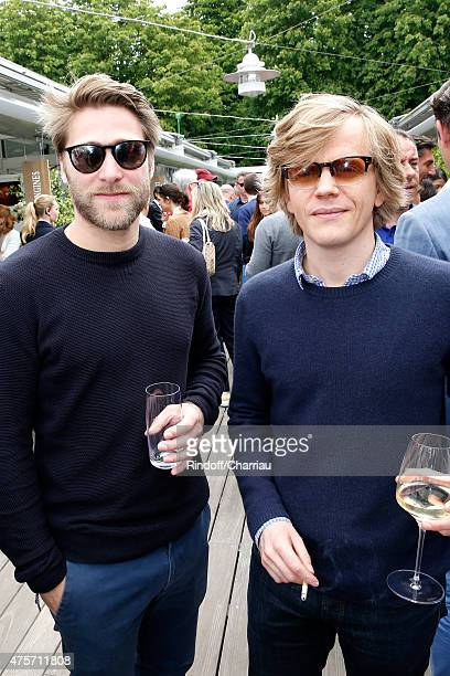 Actors Tom Dingler and Alex Lutz attend the 2015 Roland Garros French Tennis Open Day Eleven on June 3 2015 in Paris France