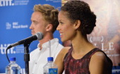 Actors Tom Felton and Gugu Mbatha Raw speak onstage at 'Belle' Press Conference during the 2013 Toronto International Film Festival at TIFF Bell...