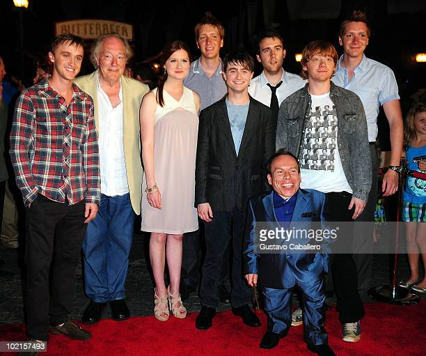 Actors Tom Felton Michael Gambon Bonnie Wright Daniel Radliffe Rupert Grint Warwick Davis James Phelps Matthew Lewis and Oliver Phelps attend the...