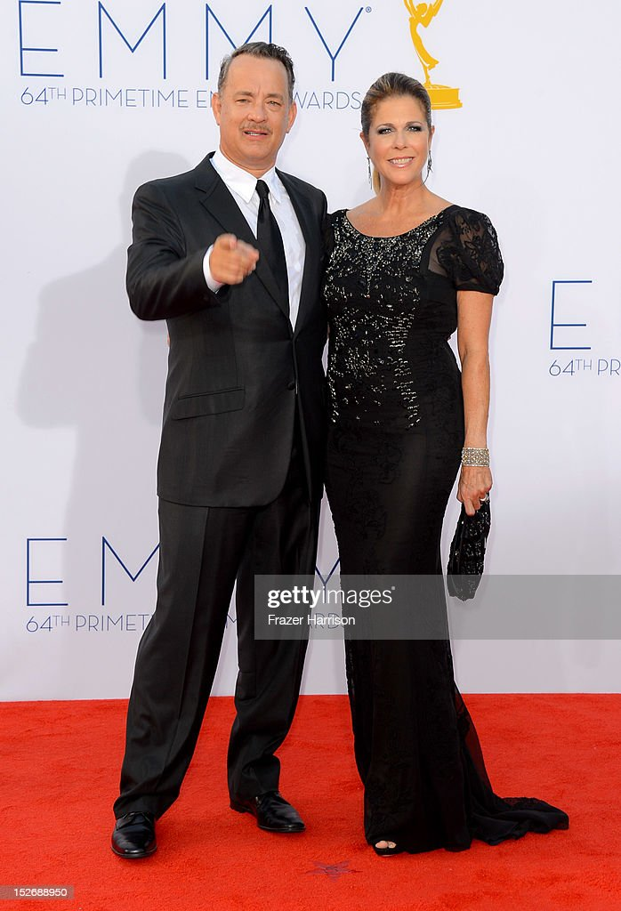 Actors <a gi-track='captionPersonalityLinkClicked' href=/galleries/search?phrase=Tom+Hanks&family=editorial&specificpeople=201790 ng-click='$event.stopPropagation()'>Tom Hanks</a> and <a gi-track='captionPersonalityLinkClicked' href=/galleries/search?phrase=Rita+Wilson+-+Actress&family=editorial&specificpeople=202642 ng-click='$event.stopPropagation()'>Rita Wilson</a> arrive at the 64th Annual Primetime Emmy Awards at Nokia Theatre L.A. Live on September 23, 2012 in Los Angeles, California.
