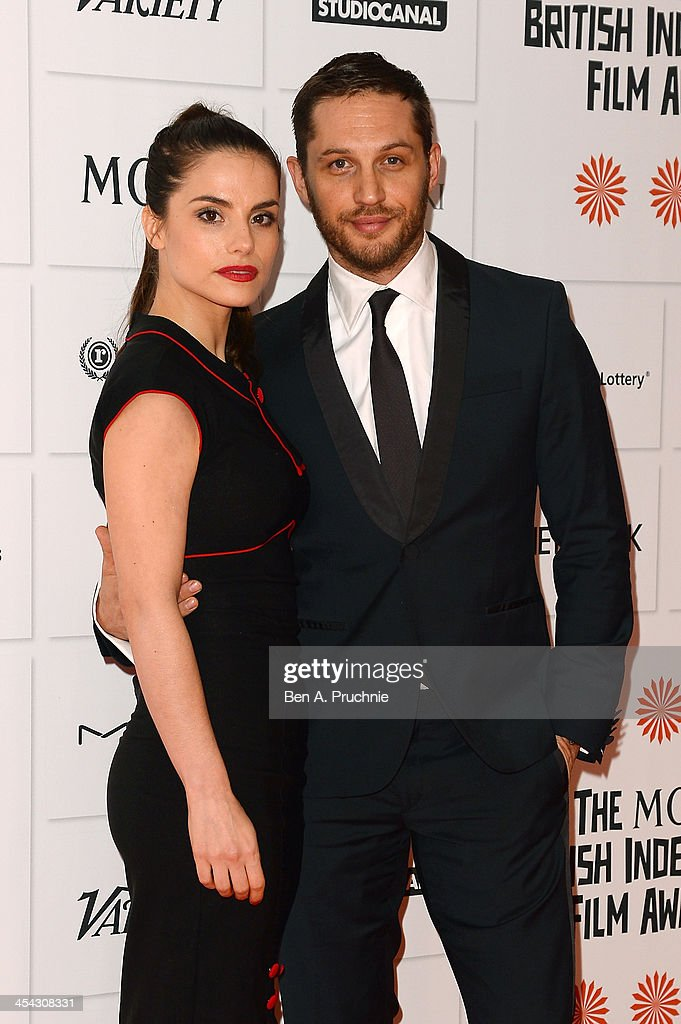 Actors Tom Hardy and Charlotte Riley arrive on the red carpet for the Moet British Independent Film Awards at Old Billingsgate Market on December 8, 2013 in London, England.