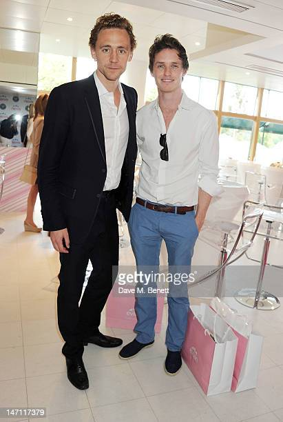 Actors Tom Hiddleston and Eddie Redmayne attend the evian 'Live young' VIP Suite at Wimbledon on June 25 2012 in London England