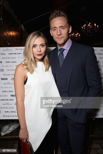Actors Tom Hiddleston and Elizabeth Olsen attend the SPC Toronto Party during the 2015 Toronto International Film Festival at Creme Brasserie on...
