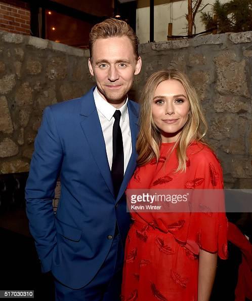 Actors Tom Hiddleston and Elizabeth Olsen pose at the after party for the premiere of Sony Pictures Classic's 'I Saw The Light' at Sadie's Kitchen on...