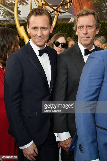 Actors Tom Hiddleston and Hugh Laurie attend the 68th Annual Primetime Emmy Awards at Microsoft Theater on September 18 2016 in Los Angeles California