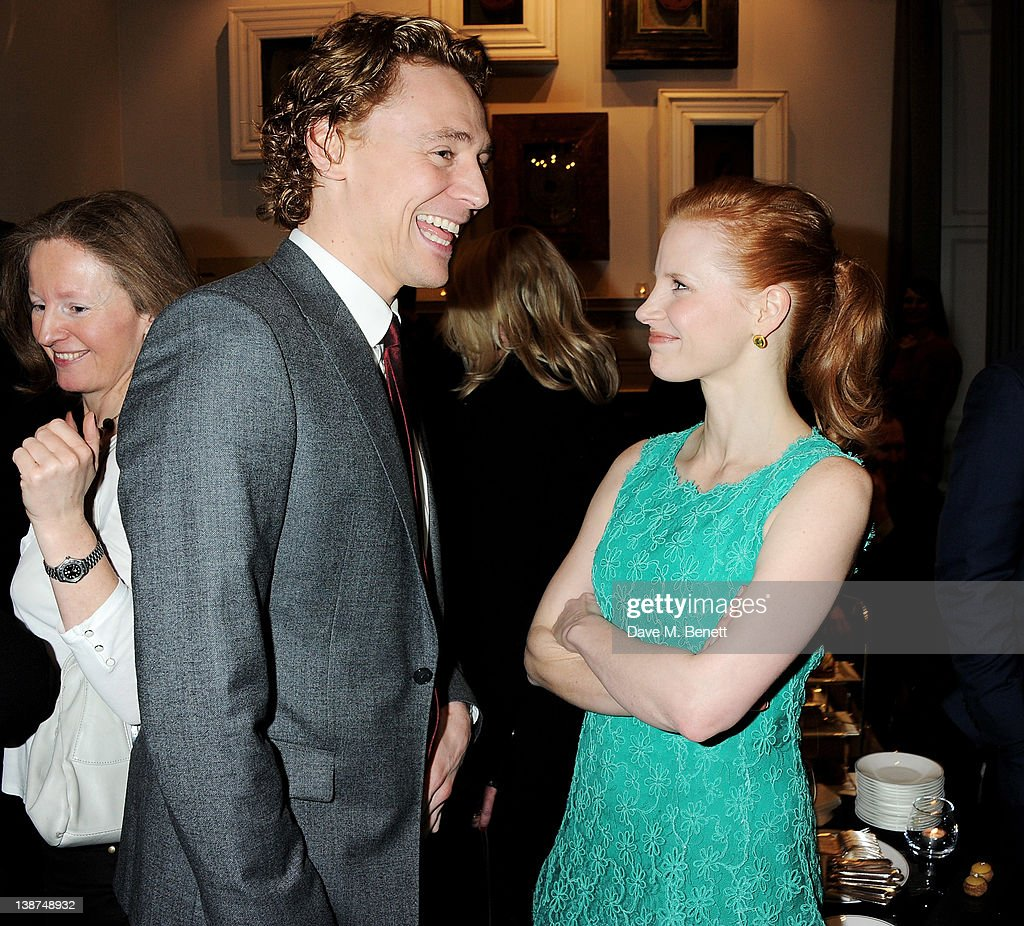 Actors Tom Hiddleston (L) and Jessica Chastain attend the Dreamworks Pre-BAFTA Tea Party in celebration of 'The Help' and 'War Horse' at The Arts Club on February 11, 2012 in London, England.