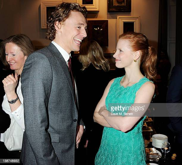 Actors Tom Hiddleston and Jessica Chastain attend the Dreamworks PreBAFTA Tea Party in celebration of 'The Help' and 'War Horse' at The Arts Club on...