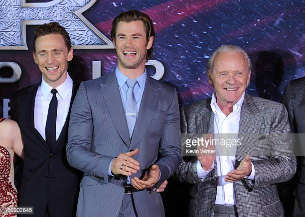 Actors Tom Hiddleston Chris Hemsworth and Anthony Hopkins arrive at the premiere of Marvel's 'Thor The Dark World' at the El Capitan Theatre on...