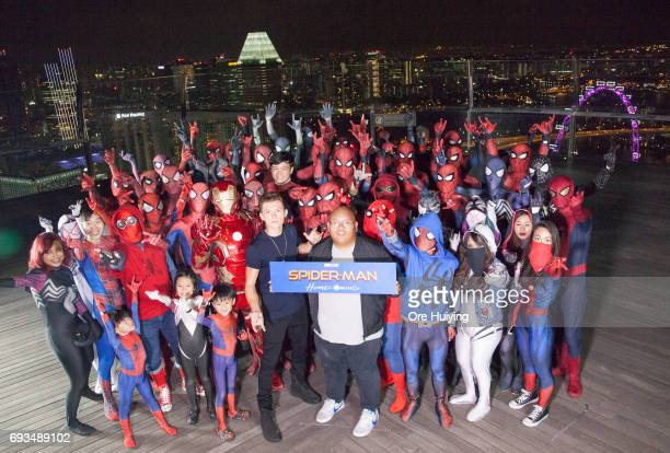 Actors Tom Holland and Jacob Batalon pose with fans during the 'SpiderMan Homecoming' event at Marina Bay Sands on June 6 2017 in Singapore