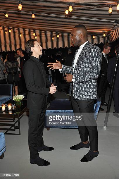 Actors Tom Holland and Mahershala Ali attend a private dinner hosted by GQ and Dior Homme in celebration of the 2016 GQ Men of The Year party at...