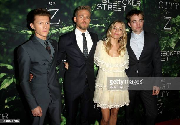 Actors Tom Holland Charlie Hunnam Sienna Miller and Robert Pattinson attend the premiere of Amazon Studios' 'The Lost City Of Z' at ArcLight...