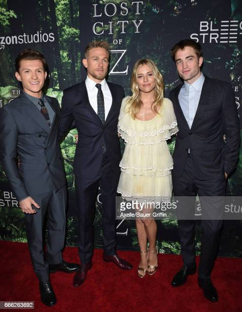 Actors Tom Holland Charlie Hunnam Sienna Miller and Robert Pattinson arrive at the Premiere of Amazon Studios' 'The Lost City of Z' at ArcLight...