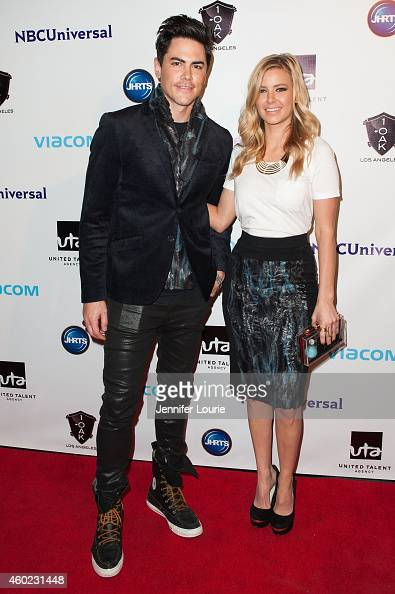 Actors Tom Sandoval and Ariana Madix arrive at the Junior Hollywood Radio Television Society's 12th Annual Holiday Party at 1OAK on December 9 2014...