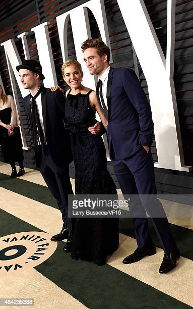 Actors Tom Sturridge Sienna Miller and Robert Pattinson attend the 2015 Vanity Fair Oscar Party hosted by Graydon Carter at the Wallis Annenberg...