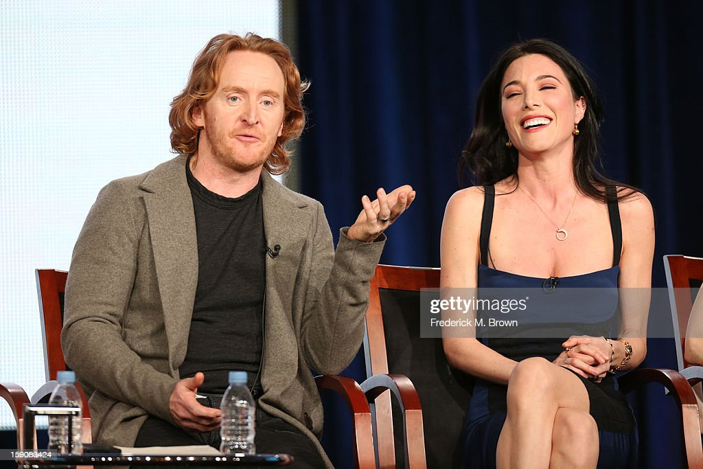 Actors Tony Curran (L) and Jaime Murray speak onstage at the 'Defiance' panel discussion during the Syfy portion of the 2013 Winter TCA Tour- Day 4 at the Langham Hotel on January 7, 2013 in Pasadena, California.