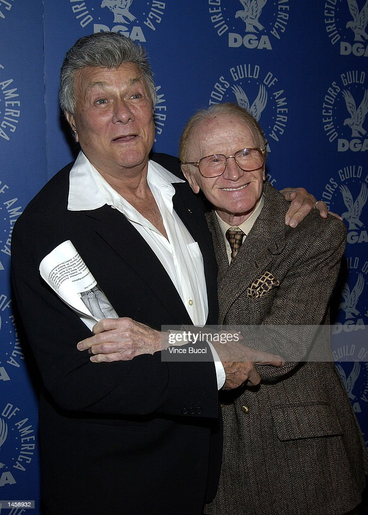 Actors Tony Curtis and Red Buttons (R) attend a tribute to the career of the late director George Sidney on October 3, 2002 at the Directors Guild of America in Hollywood, California.