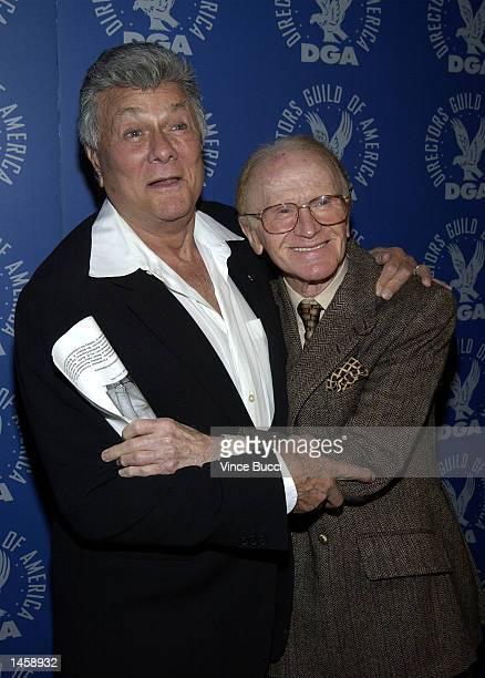 Actors Tony Curtis and Red Buttons attend a tribute to the career of the late director George Sidney on October 3 2002 at the Directors Guild of...