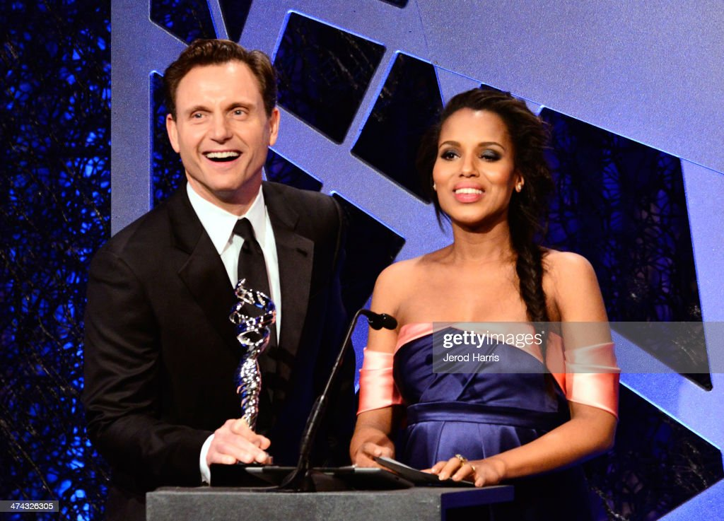 Actors <a gi-track='captionPersonalityLinkClicked' href=/galleries/search?phrase=Tony+Goldwyn&family=editorial&specificpeople=234897 ng-click='$event.stopPropagation()'>Tony Goldwyn</a> (L) and <a gi-track='captionPersonalityLinkClicked' href=/galleries/search?phrase=Kerry+Washington&family=editorial&specificpeople=201534 ng-click='$event.stopPropagation()'>Kerry Washington</a> speak onstage during the 16th Costume Designers Guild Awards with presenting sponsor Lacoste at The Beverly Hilton Hotel on February 22, 2014 in Beverly Hills, California.