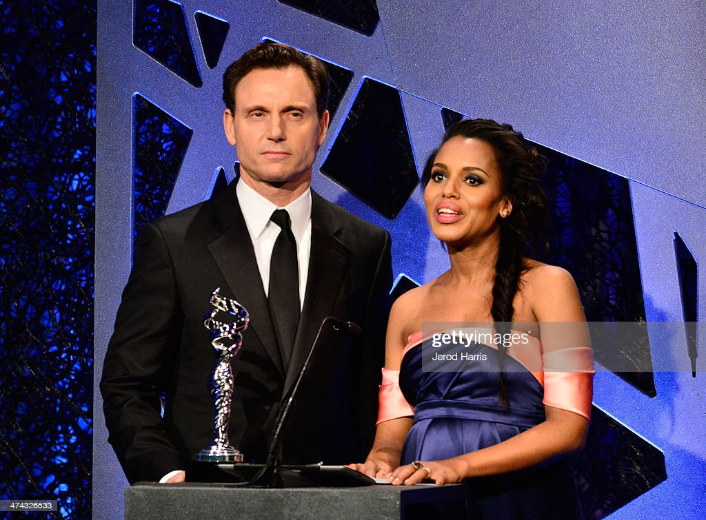 Actors Tony Goldwyn (L) and Kerry Washington speak onstage during the 16th Costume Designers Guild Awards with presenting sponsor Lacoste at The Beverly Hilton Hotel on February 22, 2014 in Beverly Hills, California.