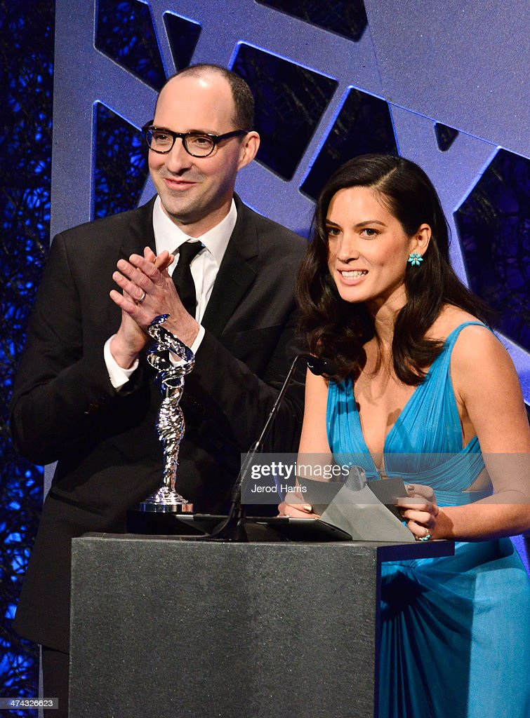 Actors Tony Hale (L) and Olivia Munn speak onstage during the 16th Costume Designers Guild Awards with presenting sponsor Lacoste at The Beverly Hilton Hotel on February 22, 2014 in Beverly Hills, California.