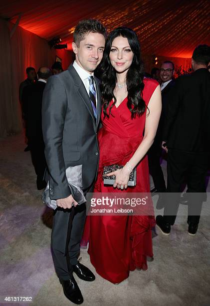 Actors Topher Grace and Laura Prepon attend the 8th Annual HEAVEN Gala presented by Art of Elysium and Samsung Galaxy at Hangar 8 on January 10 2015...