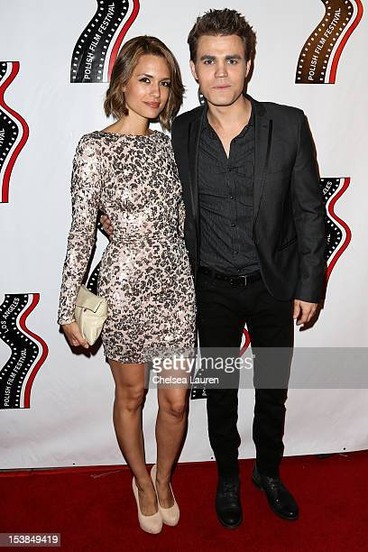 Actors Torrey DeVitto and Paul Wesley arrive at the 13th annual Polish film festival at American Cinematheque's Egyptian Theatre on October 9 2012 in...