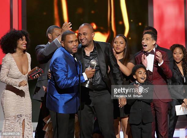 Actors Tracee Ellis Ross Laurence Fishburne host Anthony Anderson writer Kenya Barris Leyah Barris Miles Brown Marcus Scribner and Deon Cole accept...