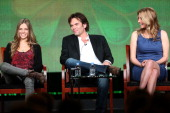 Actors Tracy Spiridakos Billy Burke and Elizabeth Mitchell speak onstage at the 'Revolution' panel session during the NBCUniversal portion of the...