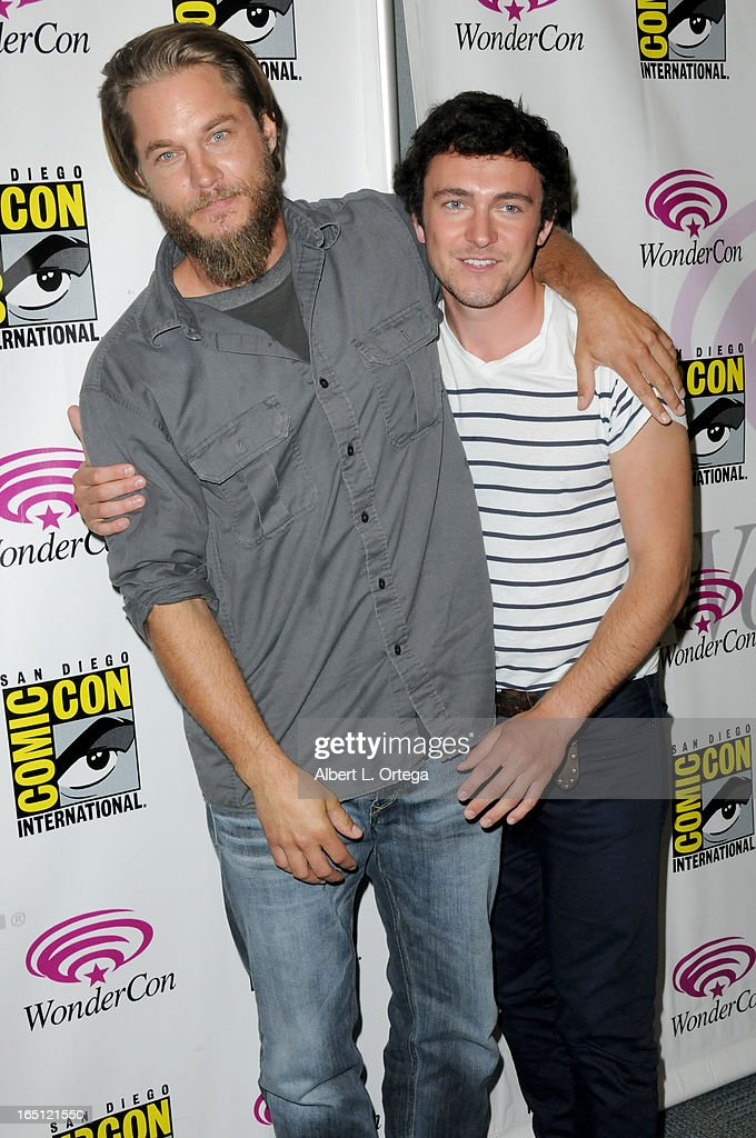 Actors <a gi-track='captionPersonalityLinkClicked' href=/galleries/search?phrase=Travis+Fimmel&family=editorial&specificpeople=3144066 ng-click='$event.stopPropagation()'>Travis Fimmel</a> and George Blagden participate at WonderCon Anaheim 2013 - Day 2 at Anaheim Convention Center on March 30, 2013 in Anaheim, California.