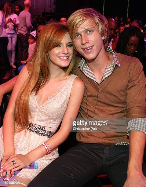 Actors Tristan Klier and Bella Throne attend the 2012 Do Something Awards at Barker Hangar on August 19 2012 in Santa Monica California