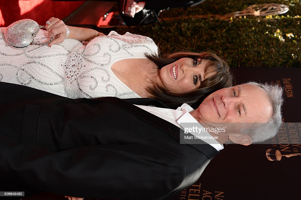 Actors Tristan Rogers (R) and Kate Linder walk the red carpet at the 43rd Annual Daytime Emmy Awards at the Westin Bonaventure Hotel on May 1, 2016 in Los Angeles, California.