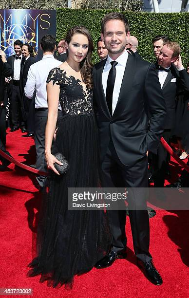 Actors Troian Bellisario and Patrick J Adams attend the 2014 Creative Arts Emmy Awards at the Nokia Theatre LA Live on August 16 2014 in Los Angeles...