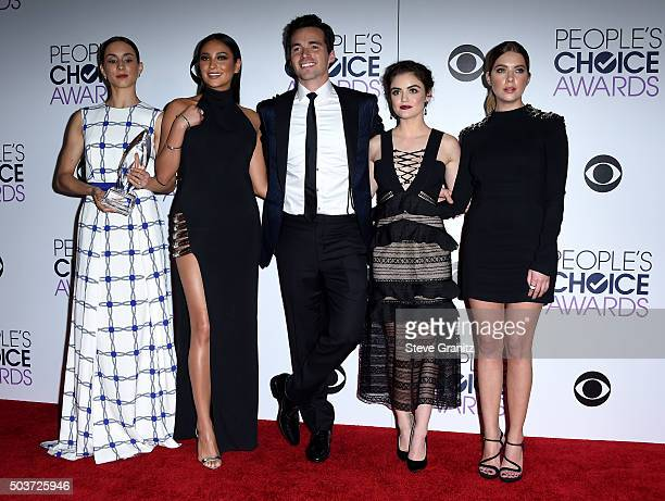 Actors Troian Bellisario Shay Mitchell Ian Harding Lucy Hale and Ashley Benson pose with an award in the press room during the People's Choice Awards...