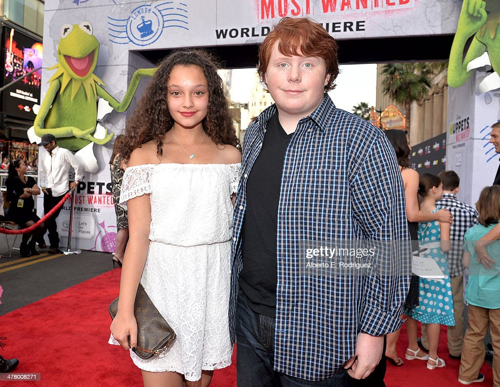 Actors Tucker Albrizzi and Kayla Maisonet arrive at the world premiere of Disney's 'Muppets Most Wanted' at the El Capitan Theatre on March 11 2014...