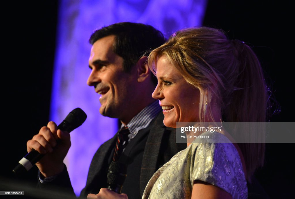 Actors Ty Burell and Julia Bowen on stage at The Saban Free Clinic's Gala Honoring ABC Entertainment Group President Paul Lee And Bob Broder at The Beverly Hilton Hotel on November 19, 2012 in Beverly Hills, California.