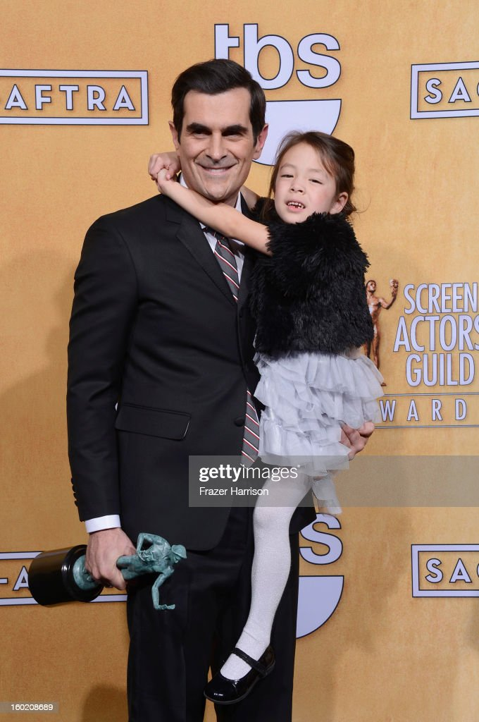 Actors Ty Burrell and Aubrey Anderson-Emmons, winners of Outstanding Performance by an Ensemble in a Comedy Series for 'Modern Family,' pose in the press room during the 19th Annual Screen Actors Guild Awards held at The Shrine Auditorium on January 27, 2013 in Los Angeles, California.