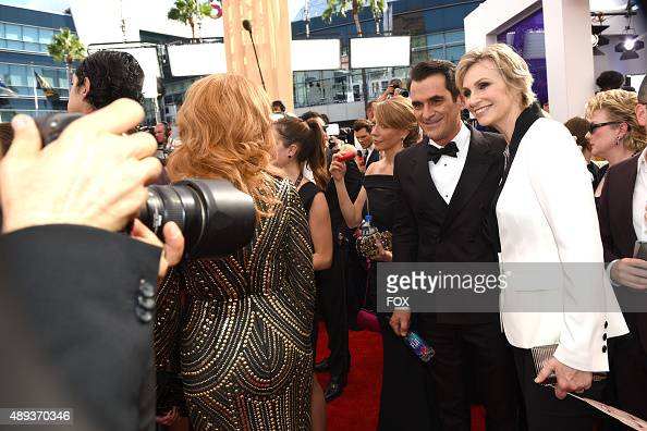 Actors Ty Burrell and Jane Lynch attend the 67th Annual Primetime Emmy Awards at Microsoft Theater on September 20 2015 in Los Angeles California