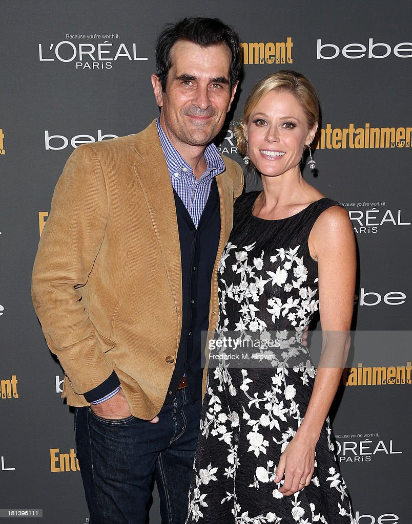 Actors <a gi-track='captionPersonalityLinkClicked' href=/galleries/search?phrase=Ty+Burrell&family=editorial&specificpeople=700077 ng-click='$event.stopPropagation()'>Ty Burrell</a> (L) and <a gi-track='captionPersonalityLinkClicked' href=/galleries/search?phrase=Julie+Bowen&family=editorial&specificpeople=244057 ng-click='$event.stopPropagation()'>Julie Bowen</a> arrive at Entertainment Weekly's Pre-Emmy Party at Fig & Olive Melrose Place on September 20, 2013 in West Hollywood, California.