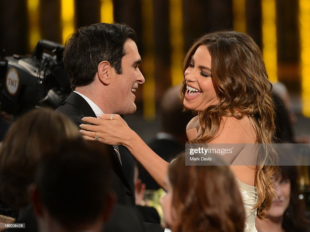Actors Ty Burrell (L) and Sofía Vergara react after winning Outstanding Performance by an Ensemble in a Comedy Series for 'Modern Family' during the 19th Annual Screen Actors Guild Awards held at The Shrine Auditorium on January 27, 2013 in Los Angeles, California.