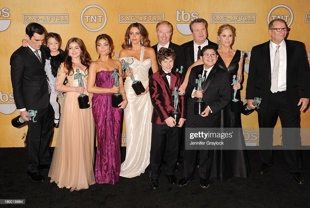 Actors Ty Burrell, Aubrey Anderson-Emmons, Ariel Winter, Sarah Hyland, Sofia Vergara, Nolan Gould, Jesse Tyler Ferguson, Eric Stonestreet, Rico Rodriguez, Julie Bowen and Ed O'Neill arrive to 19th Annual Screen Actors Guild Awards at The Shrine Auditorium on January 27, 2013 in Los Angeles, California.
