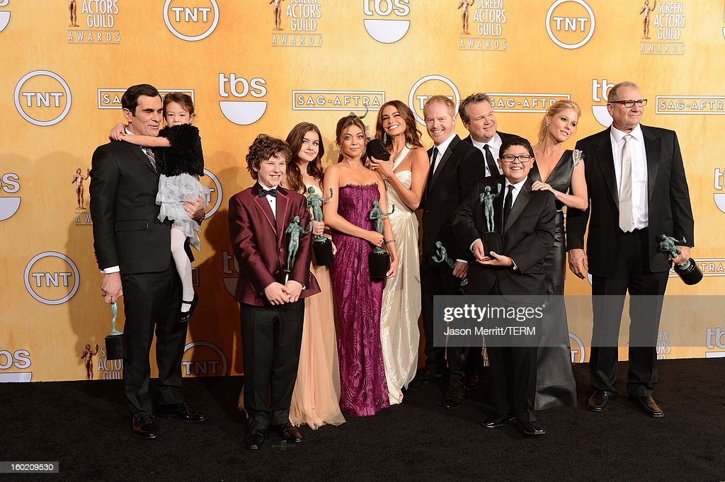 Actors <a gi-track='captionPersonalityLinkClicked' href=/galleries/search?phrase=Ty+Burrell&family=editorial&specificpeople=700077 ng-click='$event.stopPropagation()'>Ty Burrell</a>, <a gi-track='captionPersonalityLinkClicked' href=/galleries/search?phrase=Aubrey+Anderson-Emmons&family=editorial&specificpeople=8203980 ng-click='$event.stopPropagation()'>Aubrey Anderson-Emmons</a>, <a gi-track='captionPersonalityLinkClicked' href=/galleries/search?phrase=Nolan+Gould&family=editorial&specificpeople=5691358 ng-click='$event.stopPropagation()'>Nolan Gould</a>, <a gi-track='captionPersonalityLinkClicked' href=/galleries/search?phrase=Ariel+Winter&family=editorial&specificpeople=715954 ng-click='$event.stopPropagation()'>Ariel Winter</a>, <a gi-track='captionPersonalityLinkClicked' href=/galleries/search?phrase=Sarah+Hyland&family=editorial&specificpeople=3989646 ng-click='$event.stopPropagation()'>Sarah Hyland</a>, <a gi-track='captionPersonalityLinkClicked' href=/galleries/search?phrase=Sofia+Vergara&family=editorial&specificpeople=214702 ng-click='$event.stopPropagation()'>Sofia Vergara</a>, <a gi-track='captionPersonalityLinkClicked' href=/galleries/search?phrase=Jesse+Tyler+Ferguson&family=editorial&specificpeople=633114 ng-click='$event.stopPropagation()'>Jesse Tyler Ferguson</a>, <a gi-track='captionPersonalityLinkClicked' href=/galleries/search?phrase=Eric+Stonestreet&family=editorial&specificpeople=6129010 ng-click='$event.stopPropagation()'>Eric Stonestreet</a>, Rico Rodriguez, <a gi-track='captionPersonalityLinkClicked' href=/galleries/search?phrase=Julie+Bowen&family=editorial&specificpeople=244057 ng-click='$event.stopPropagation()'>Julie Bowen</a> and <a gi-track='captionPersonalityLinkClicked' href=/galleries/search?phrase=Ed+O%27Neill&family=editorial&specificpeople=777163 ng-click='$event.stopPropagation()'>Ed O'Neill</a> attend the 19th Annual Screen Actors Guild Awards at The Shrine Auditorium on January 27, 2013 in Los Angeles, California. (Photo by Jason Merritt/WireImage) 23116_014_3127.JPG