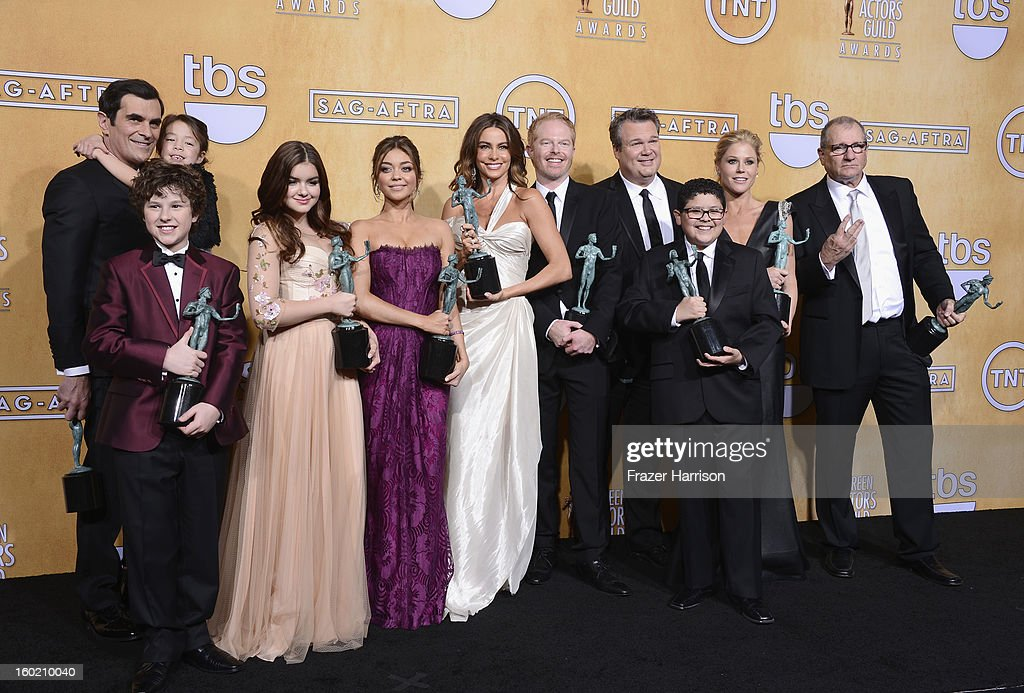 Actors Ty Burrell, Aubrey Anderson-Emmons, Nolan Gould, Ariel Winter, Sarah Hyland, Sofia Vergara, Jesse Tyler Ferguson, Eric Stonestreet, Rico Rodriguez, Julie Bowen and Ed O'Neill, winners of Outstanding Performance by an Ensemble in a Comedy Series for 'Modern Family,' pose in the press room during the 19th Annual Screen Actors Guild Awards held at The Shrine Auditorium on January 27, 2013 in Los Angeles, California.