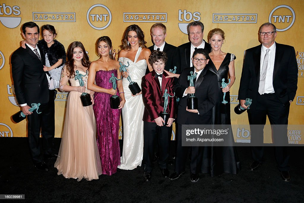Actors Ty Burrell, Aubrey Anderson-Emmons, Nolan Gould, Ariel Winter, Sarah Hyland, Sofia Vergara, Jesse Tyler Ferguson, Eric Stonestreet, Rico Rodriguez, Julie Bowen, and Ed O'Neill pose in the press room during the 19th Annual Screen Actors Guild Awards held at The Shrine Auditorium on January 27, 2013 in Los Angeles, California.