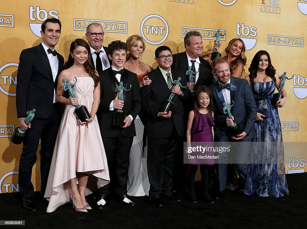 Actors Ty Burrell, Ed O'Neill, Nolan Gould, Julie Bowem, Rico Rodriguez, <a gi-track='captionPersonalityLinkClicked' href=/galleries/search?phrase=Eric+Stonestreet&family=editorial&specificpeople=6129010 ng-click='$event.stopPropagation()'>Eric Stonestreet</a>, Sofía Vergara, Ariel Winter and <a gi-track='captionPersonalityLinkClicked' href=/galleries/search?phrase=Sarah+Hyland&family=editorial&specificpeople=3989646 ng-click='$event.stopPropagation()'>Sarah Hyland</a> and (Front L-R) Aubrey Anderson-Emmons and Jesse Tyler Ferguson pose in the press room with the award for Outstanding Performance by an Ensemble in a Comedy Series for 'Modern Family' at the 20th Annual Screen Actors Guild Awards at the Shrine Auditorium on January 18, 2014 in Los Angeles, California.
