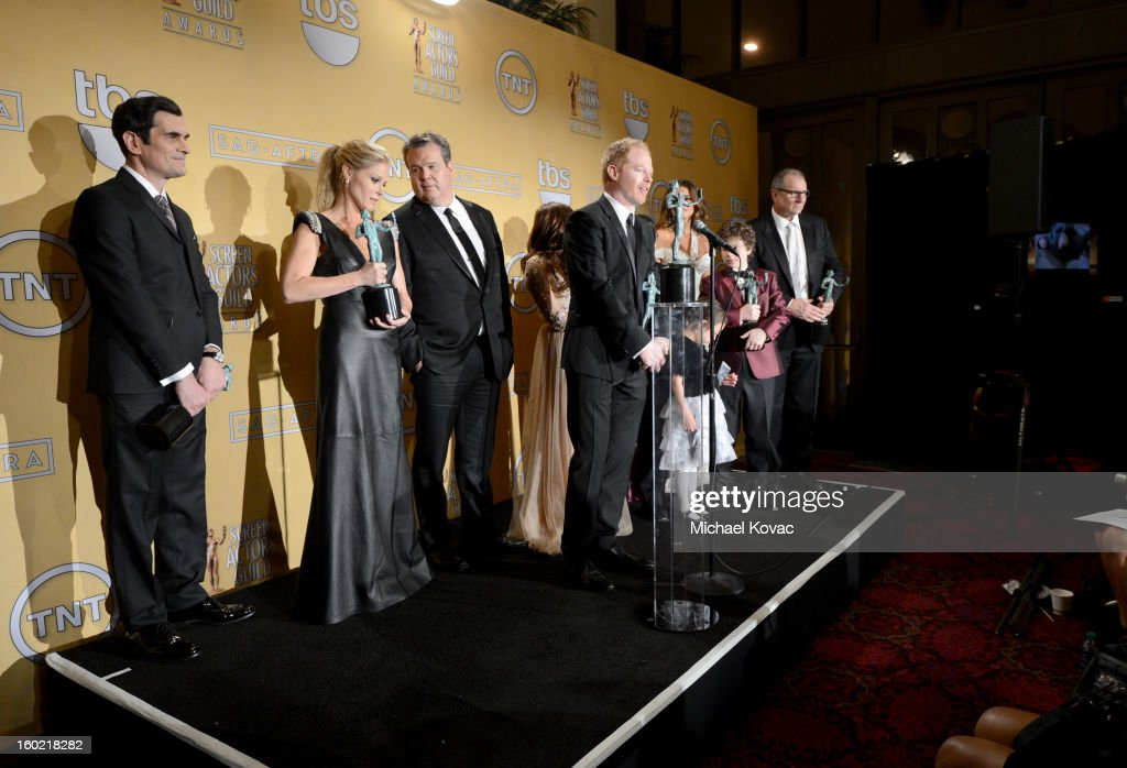 Actors Ty Burrell, Julie Bowen, Eric Stonestreet, Jesse Tyler Ferguson, Ariel Winter, Sofia Vergara, Nolan Gould, and Ed O'Neill, winners of Outstanding Performance by an Ensemble in a Comedy Series for 'Modern Family,' backstage during the19th Annual Screen Actors Guild Awards at The Shrine Auditorium on January 27, 2013 in Los Angeles, California. (Photo by Michael Kovac/WireImage) 23116_026_0711.JPG