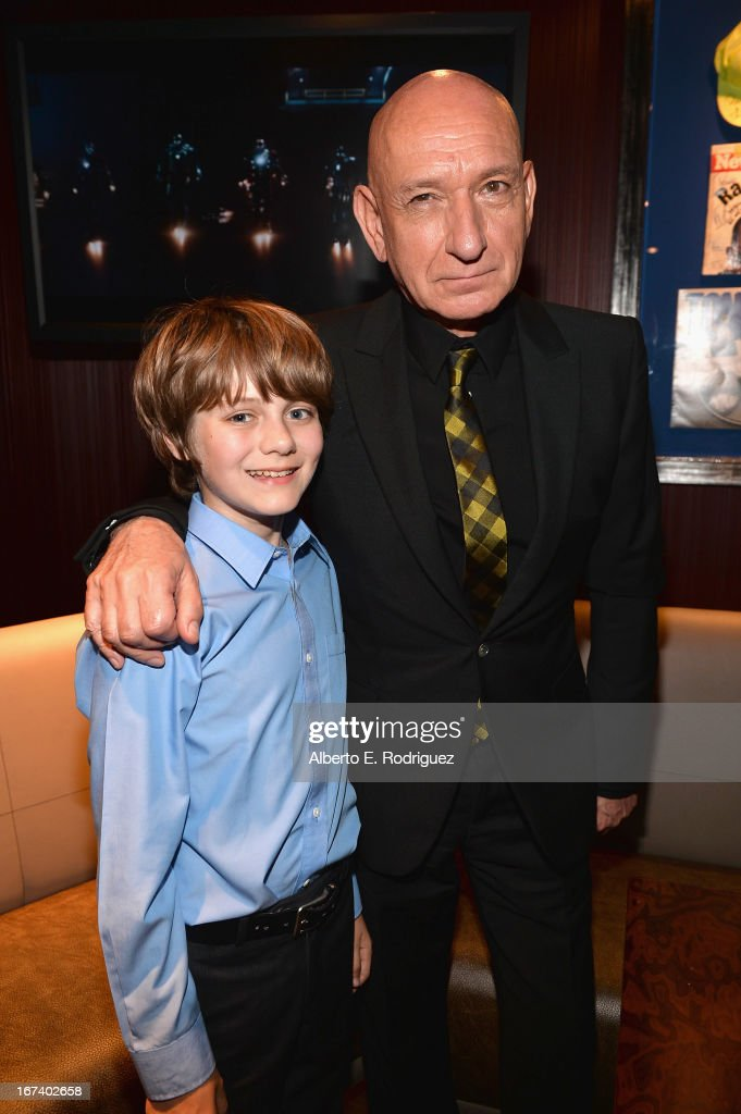 Actors Ty Simpkins and Ben Kingsley attend Marvel's Iron Man 3 Premiere after party at Hard Rock Cafe on April 24, 2013 in Hollywood, California.