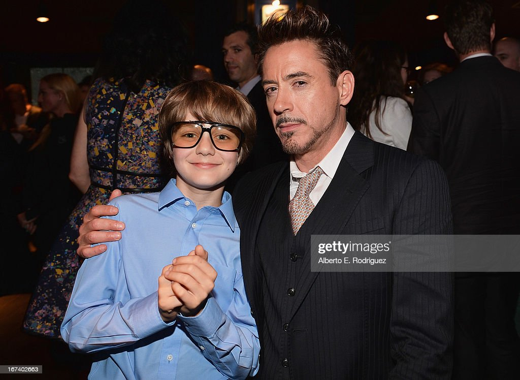 Actors Ty Simpkins and <a gi-track='captionPersonalityLinkClicked' href=/galleries/search?phrase=Robert+Downey+Jr.&family=editorial&specificpeople=204137 ng-click='$event.stopPropagation()'>Robert Downey Jr.</a> attend Marvel's Iron Man 3 Premiere after party at Hard Rock Cafe on April 24, 2013 in Hollywood, California.