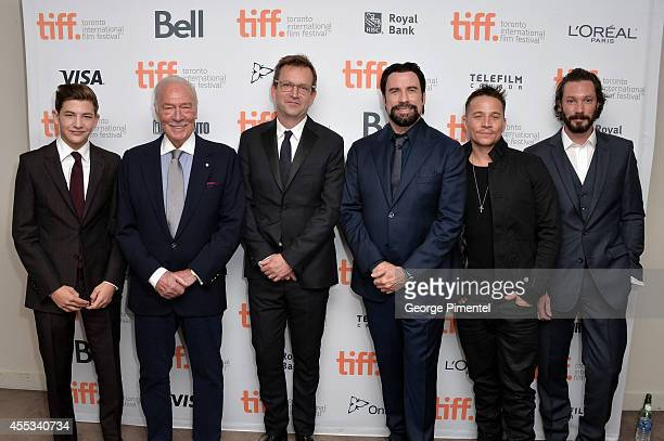 Actors Tye Sheridan Christopher Plummer Director Philip Martin actors John Travolta Travis Aaron Wade and Bryan Veronneau attend 'The Forger'...